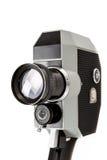 在白色的老8mm电影摄影机 免版税库存照片