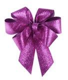在白色的聪明的紫色弓 库存图片