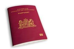 在白色的荷兰语护照 库存照片