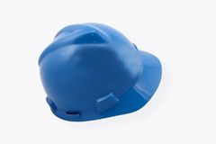 在白色的蓝色安全帽 库存照片
