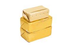 在白色的被包裹的黄油棍子 库存图片