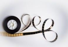 在白色的被展开的35 mm影片 免版税库存图片