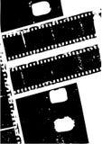 在白色的被用完的底片剪影 免版税库存照片