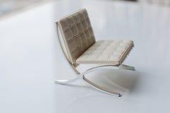 在白色的设计师椅子 免版税库存图片
