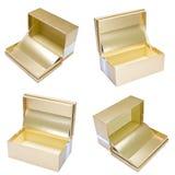 在白色的金黄礼物盒 免版税库存照片