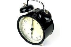 在白色的闹钟,显示六个o `时钟 图库摄影