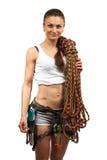 在白色的年轻女性攀岩运动员 免版税库存图片