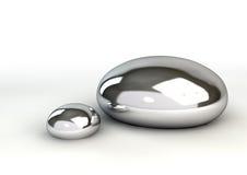 在白色的水星小滴 免版税库存照片
