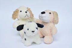 在白色的3条狗玩偶 库存图片