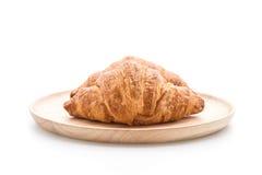 在白色的黄油新月形面包 库存照片