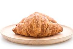在白色的黄油新月形面包 库存图片