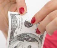 在白色的100美元断裂 免版税库存图片