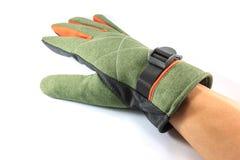 在白色的绿色冬天手套 库存图片