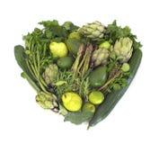 在白色的绿色素食者心脏 库存图片