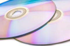 在白色的CD的DVD 免版税库存照片