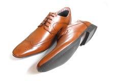 在白色的Tan鞋子 免版税库存图片