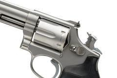 在白色竖起的不锈的357个大酒瓶左轮手枪 免版税库存图片