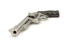 在白色竖起的不锈的357个大酒瓶左轮手枪 免版税图库摄影