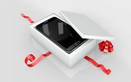 在白色纸板的一个手机 免版税库存照片