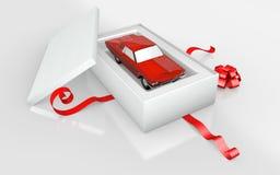 在白色纸板的一辆玩具汽车 免版税库存照片