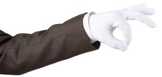 在白色纺织品手套的人的手 库存照片
