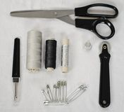在白色织品-图象的缝合的辅助部件 免版税图库摄影