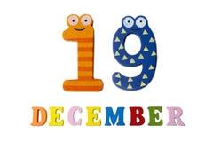 在白色背景、数字和信件的12月19日 图库摄影