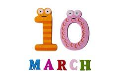 在白色背景、数字和信件的3月10日 免版税图库摄影