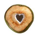 在白色背景与被删去的心脏形状的新鲜的绿色年轻椰子隔绝的 库存图片