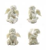 在白色背景丘比特雕象隔绝的套 免版税库存图片