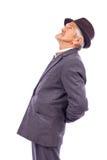一个老人的画象充满背部疼痛的 库存照片