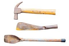 在白色背景和刀子隔绝的铁锹、锤子 库存图片
