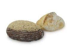 在白色背景和大面包隔绝的荞麦面包 图库摄影