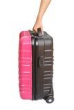 在白色背景和手隔绝的手提箱 免版税库存图片