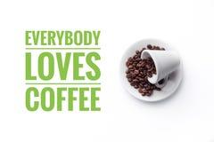 在白色背景和消息`的一个杯子大家爱咖啡` 免版税库存照片
