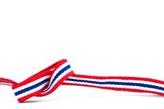 在白色背景和空白的区域的泰国旗子丝带样式 库存图片