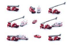 在白色背景和红色汽车隔绝的拼贴画玩具消防车、救护车 免版税图库摄影