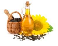 在白色背景和花隔绝的向日葵油、种子 库存照片