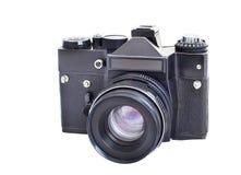 在白色背景在影片35mm格式的单一透镜反光照相机隔绝的 免版税库存照片