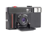 在白色背景在影片35mm格式的现代紧凑模式照相机隔绝的 免版税库存照片