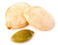 在白色背景宏指令的两粒南瓜籽 图库摄影
