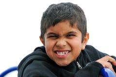 在白色背景有一个滑稽的表示的一个微笑的男孩隔绝的 免版税图库摄影