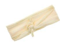 在白色背景栓的象牙丝带布料材料 图库摄影