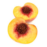 在白色背景桃子隔绝的两个一半 免版税库存照片