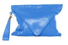 在白色背景欺骗者蓝色颜色的妇女袋子 库存图片