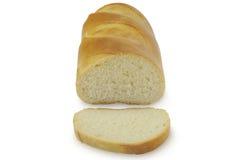 在白色背景正面图隔绝的切的长的面包 免版税图库摄影