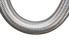 在白色背景特写镜头的结辨的金属缆绳 免版税图库摄影