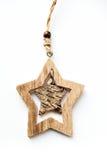以在白色背景的一个星的形式木圣诞节戏弄 图库摄影