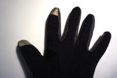 在白色背景的一副黑手套 免版税图库摄影