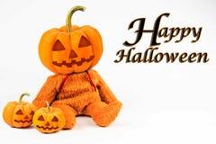 在白色背景的万圣夜南瓜与消息& x27; 愉快的Halloween& x27; 库存照片